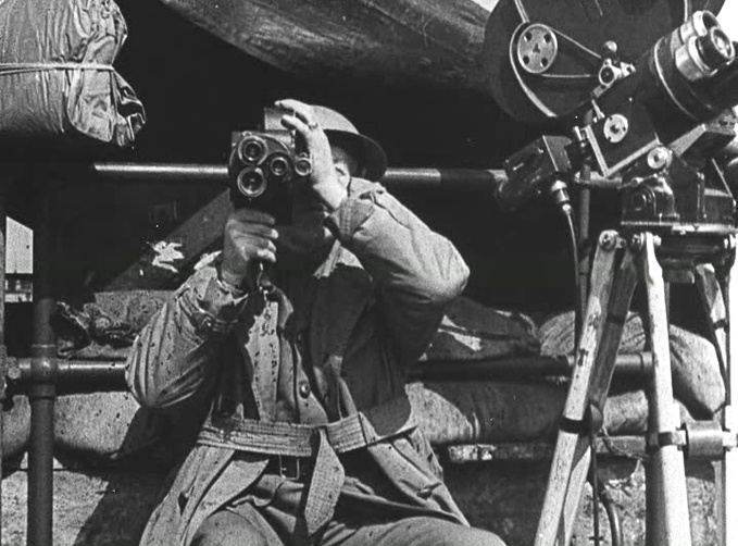 <i>Cameramen at War</i>, film still, 1943, Len Lye.