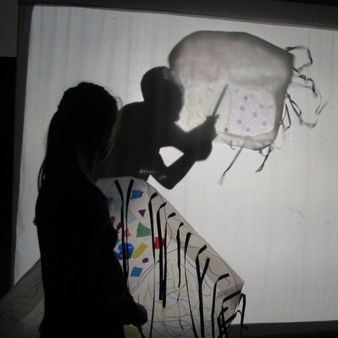 Having fun with shadow puppets at the Gallery