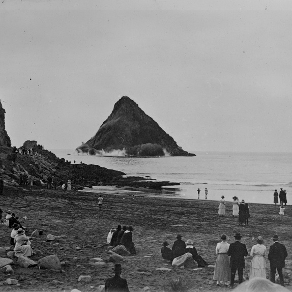 Unknown photographer, Blasting Moturoa Island for rock (1920s). Collection of Puke Ariki (PHO2007-242)