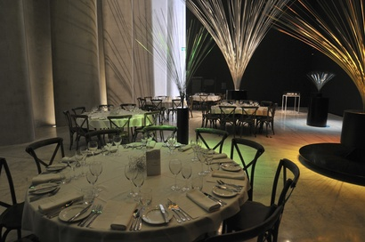 A past dinner setting in the Large Works gallery with Len Lye's <em>Fountain</em> sculptures