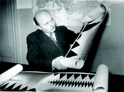 Oskar Fischinger with fake publicity scrolls, relating to his Ornament Sound experiments