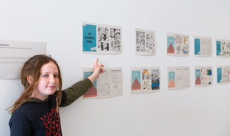 Ilaine Shuttleworth, 10, with her comic adventure at Govett-Brewster Art Gallery. Photo Rosie Moyes