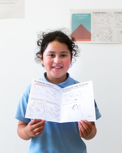 Lauren Knight, 6, with her comic adventure at the Govett-Brewster Art Gallery