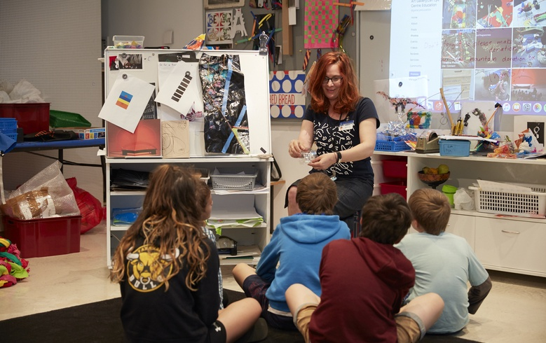 Educator Rebecca Fawkner with students in the Learning Centre