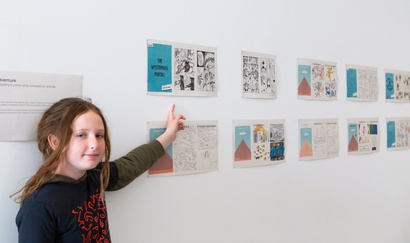 Ilaine Shuttleworth, 10, with her comic adventure at the Govett-Brewster Art Gallery