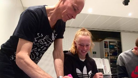 Chris Barry helps daughter Eve, 14, with hand animation filmmaking. Photo by Brittany Baker/Stuff