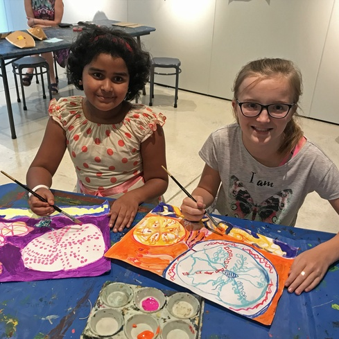 Young Visionaries Ava Carswell and Anandhi Saravanan being creative at the art gallery