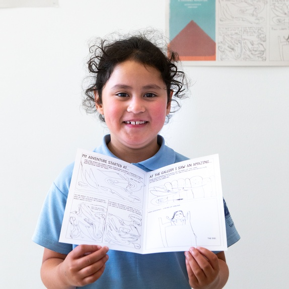 Lauren Knight, 6, with her comic adventure at Govett-Brewster Art Gallery. Photo Rosie Moyes