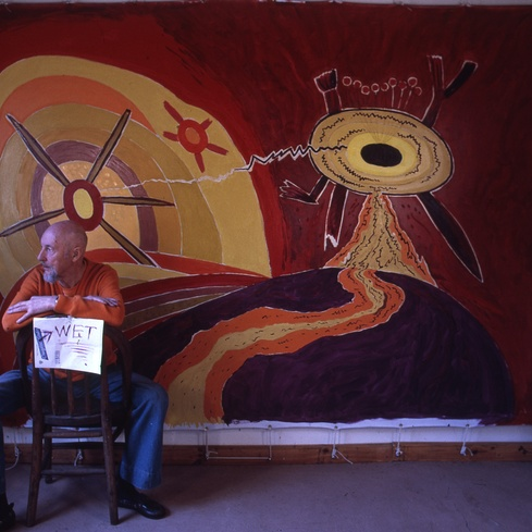 Len Lye in studio with <em>Land and Sea</em> c.1979, a painting in the <em>Big Bang Theory</em> exhibition. Courtesy of the Len Lye Foundation