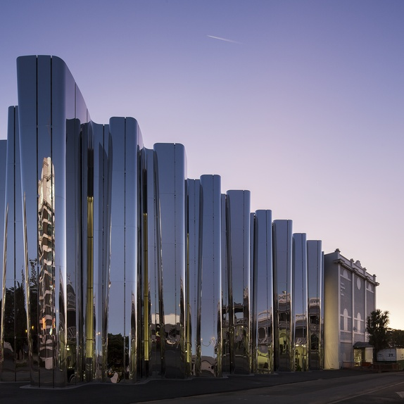 The sleek and contemporary stainless steel facade of the Len Lye Centre. Photo by Patrick Reynolds