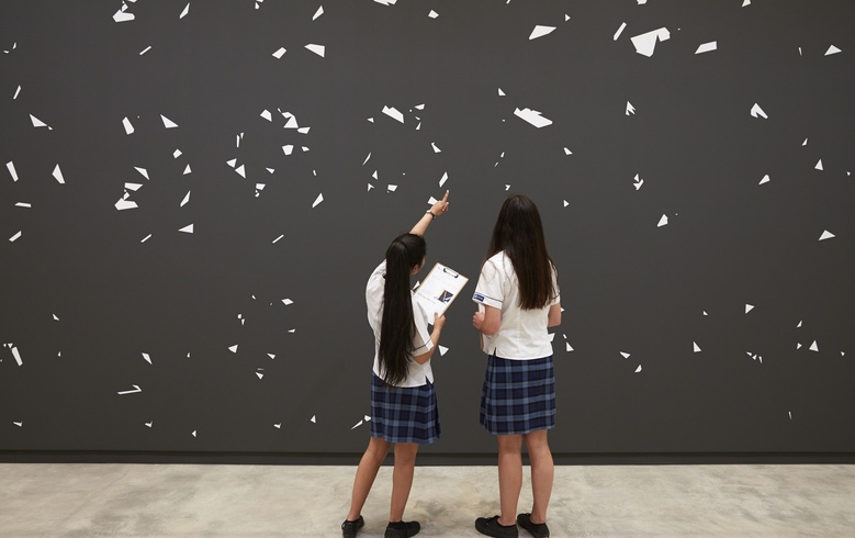 Students with Jeena Shin's painting. Photo Sam Hartnett
