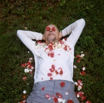 <em>Len Lye with Flower Petals</em>, c.1968. Colour photograph