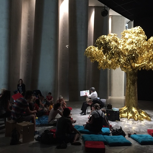 Story time under the golden tree at Govett-Brewster Art Gallery.
